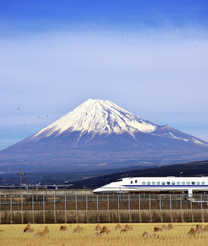 A bullet train speeds past Mt Fuji. Getty Images