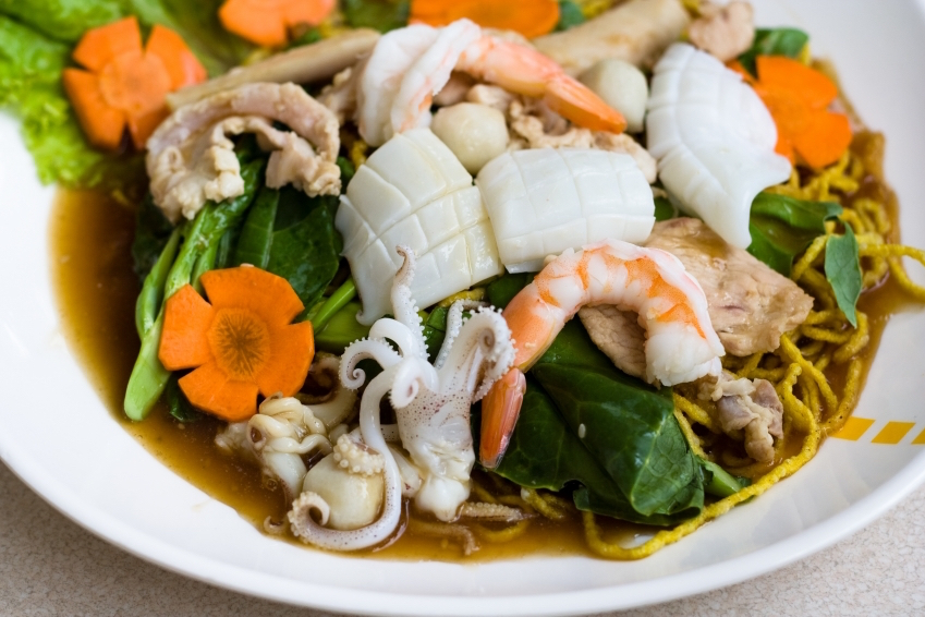 Stir-frying is a quick way of cooking : this dish is seafood with vegetables. It will be eaten with rice. Getty Images