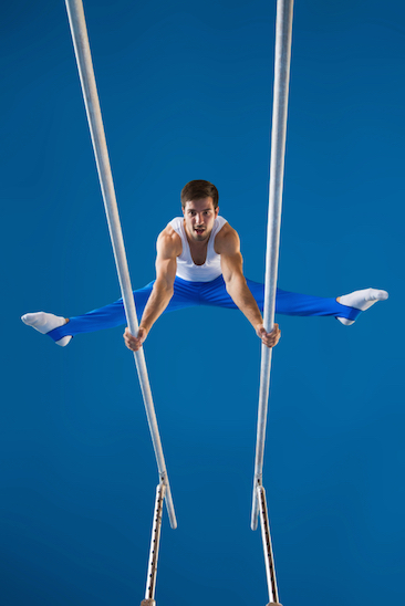 A gymnast performs a routine on the parallel bars © Getty Images