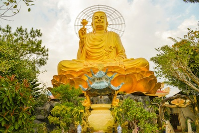 Statue of Golden Buddha, Dalat, Vietnam. Even on a cloudy day it glows. Photo©iStock