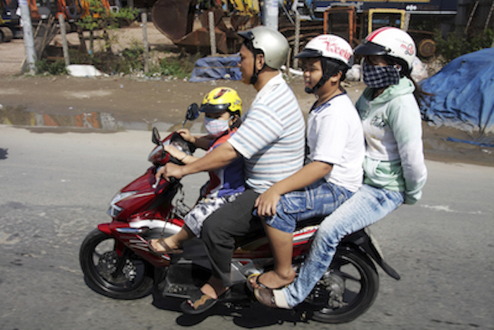 A Vietnamese family on scooter. Photo©iStock
