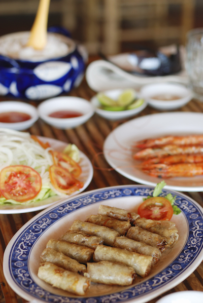 Vietnamese meal including spring rolls, salad, soup. photo©Getty