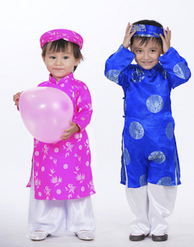 Girl and boy wearing new ao dai for New Year. Photo©iStock