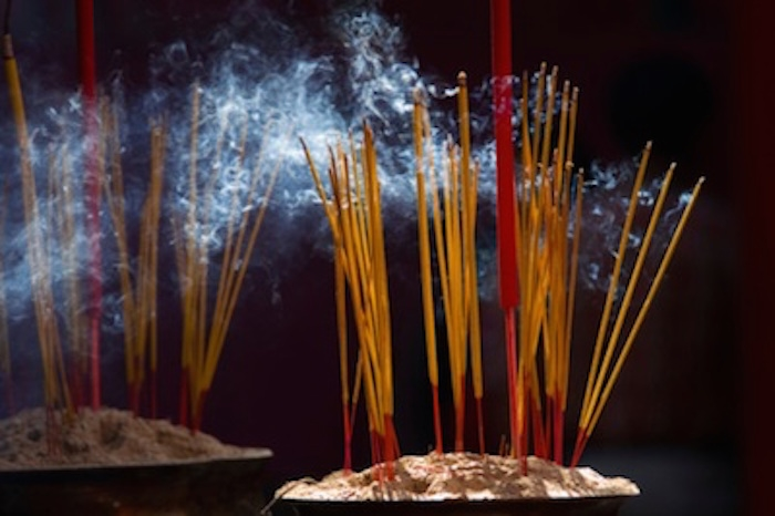 Incense sticks welcome the ancestors during Tet. Image © iStock
