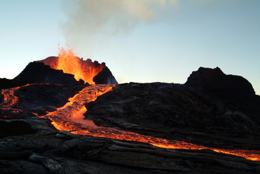 Hot lava flowing down the side of an erupting volcano. Getty Images