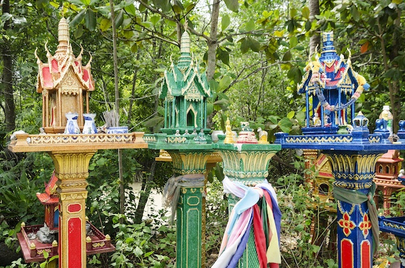 Buildings in Thailand each have a spirit house to pay respects to the spirit of that property. ©Getty
