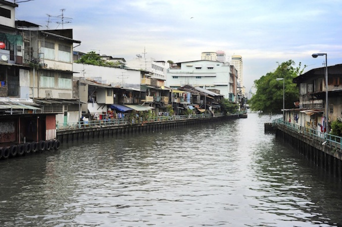 Crowded housing along a Bangkok klong. Photos.com