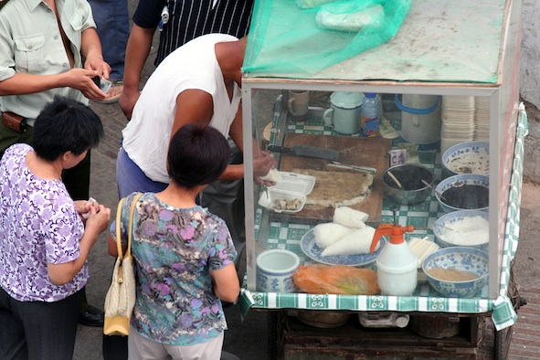 A street food stall. Photos.com