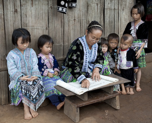 A Meo village school. They are all wearing Meo traditional clothing. iPhotos.com