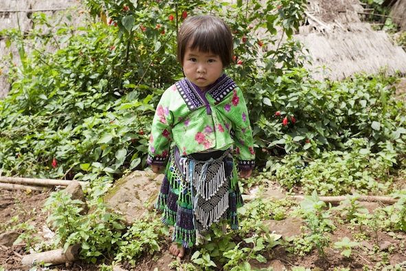 A Meo child in traditional clothing.  Photos.com