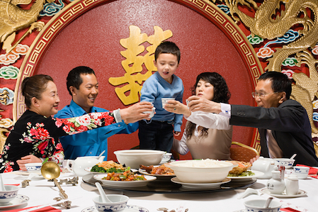 Families celebrate New year With a feast and gift giving. © Getty Images