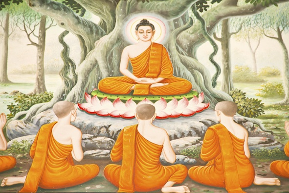 A painting of the Buddha seated under a bodhi tree to teach his followers. Getty Images