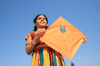 A young girl ready to fly her kite.