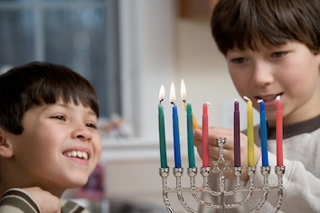 Lighting the menorah.  Can you tell which night of Hanukkah it is?
