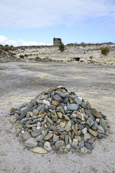 Lime quarry where prisoners broke up big rocks. The 'Remembrance Stones' - a memorial to the courage of the Robben Island political prisoners.The stones are all different colours, all together: a symbol of what they fought for. Photo©iStock