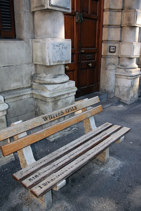 Non whites could be punished for sitting on a bench that looked the same but was labelled like this. Photo©iStock