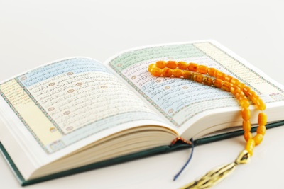 A copy of the Koran with subha or misbaha beads, which some people use as they pray. Photo©iStock