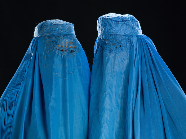 Two women wearing the burka, a garment covering them completely. ©iStock