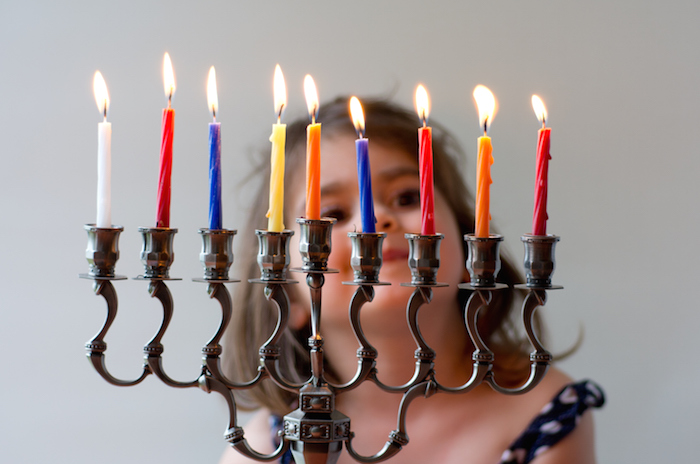 The candles on a special candlestick called the menorah are lit at Hanukkah