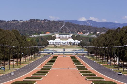 Parliament House, Canberra. The white building in the foreground is the first Parliament House built in Canberra in 1927 © iStock