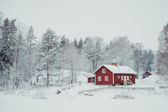 Houses in cold places have small windows and steep roofs so the snow slides off. ©Getty