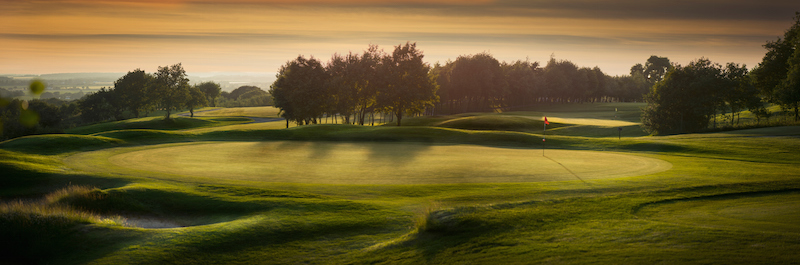 A golf course. Flags mark the holes on the greens. ©Getty