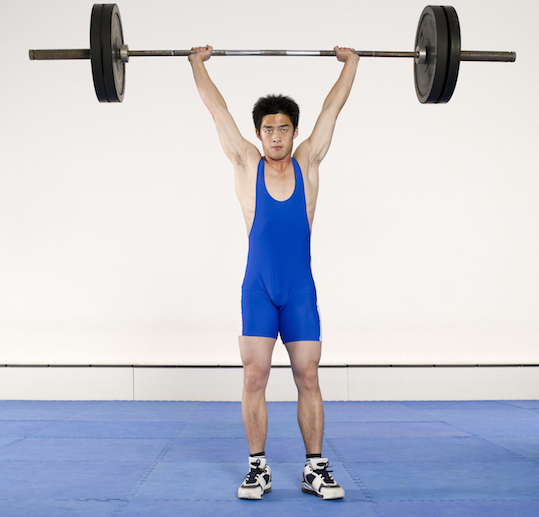 The barbell must be held above the head for two seconds. ©Getty