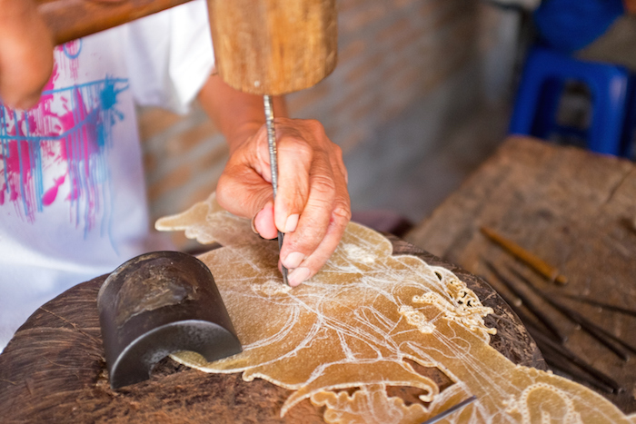 A wayang kulit puppet being made of buffalo hide. ©Getty