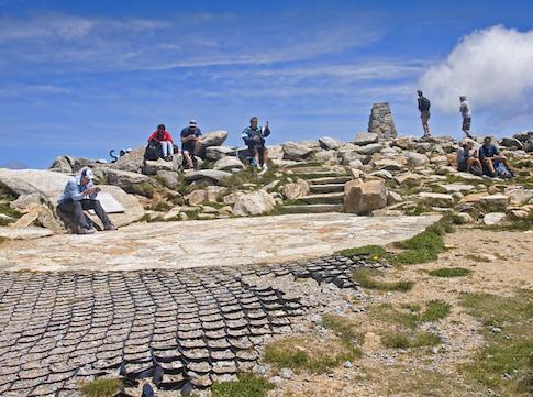 Tourists on the summit of Mount Kosciuszko. ©iStock