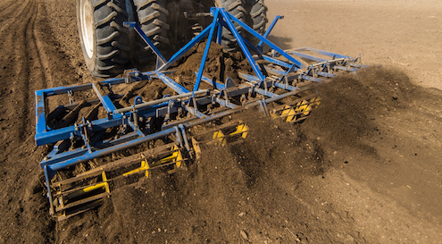 A plough digs up the soil to get it ready to take the seeds. © iStock