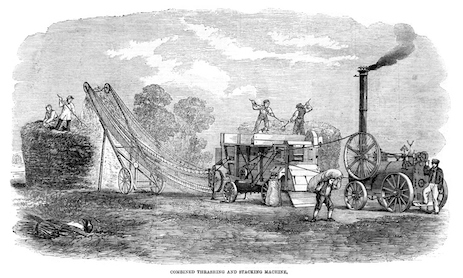 This is a machine that was used to separate grain from the plants and then stack the hay/straw into a haystack. The machine was powered by a steam engine. You can see a man carrying a sack of grain away ©iStock