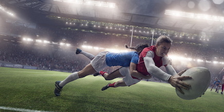 Rugby players tackle each other to try to get the ball. ©iStock