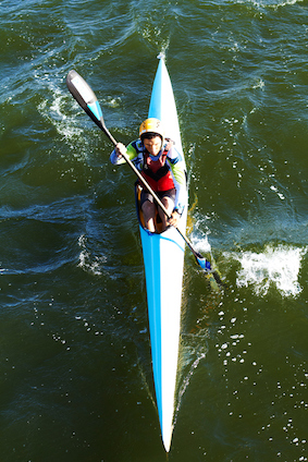 This single athletes paddles and steers the canoe with a single oar with a paddle at each end during a sprint race. ©iiStock