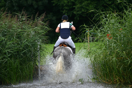 Water jumps are part of cross-country in eventing. ©iStock