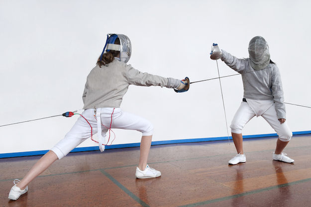 Fencing bout with the foil. Wires in the foil record when a sword touches and opponent.©iStock