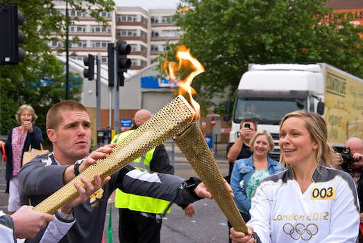 Hundreds of runners carry the torch to the Olympic venue. Each lights the torch of the next runner. ©iStock