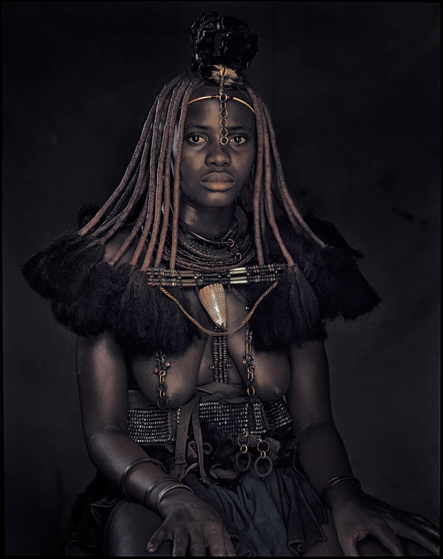 A Himba woman.  Photo credit.
