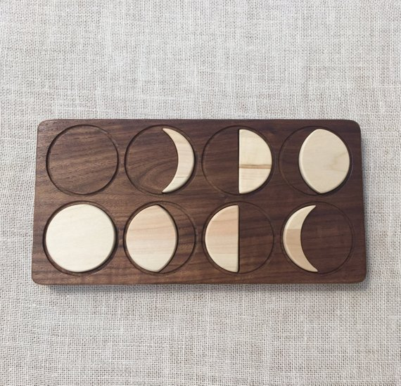 From Jennifer handcrafted toys - This is an Etsy shop that I love - many of her beautiful wooden pieces like this moon phases puzzle are on my wishlist.