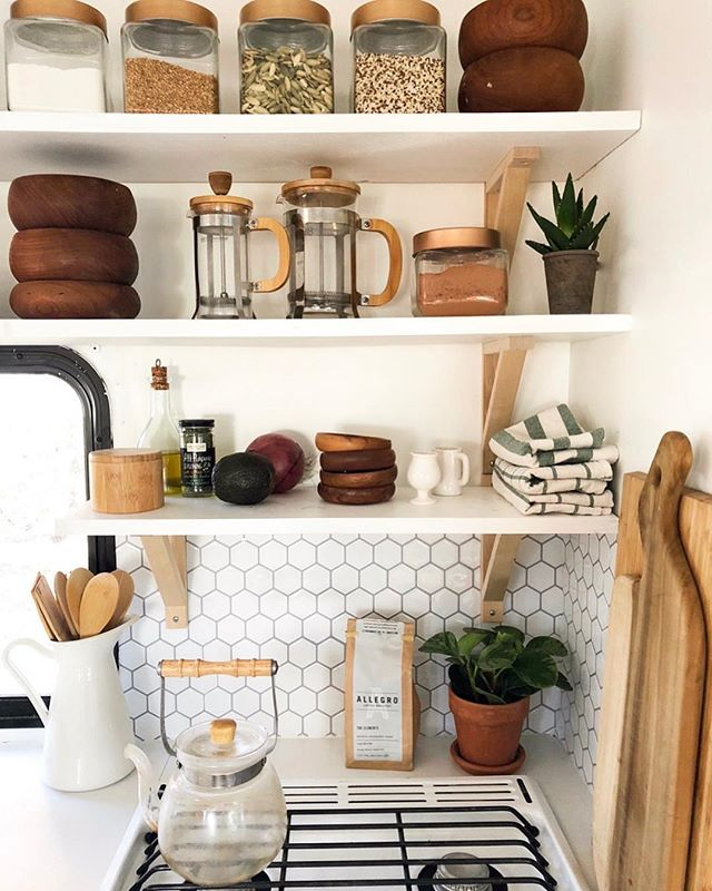 Escape from complicated life. Take refuge in the simple. You will find three treasures there: Healthy body, peaceful mind and a life away from ambitious fools. - Mehmet Murat ilda #rvliving #minimalism #tinykitchen #openshelving #rvremodel
