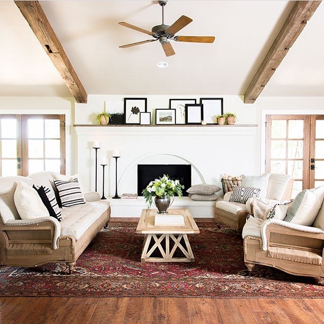 I fell in love with the vintage charm of this fireplace from @joannagaines when I saw it on @fixerupperhgtv the other day! That rug also adds just the perfect hint of color. #homeinspo #farmhouse #vintagecharm #roominspo #home #modernfarmhouse #colorpop @magnolia