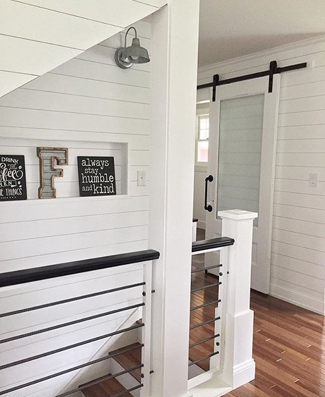 I really love all the fun banisters that are going in right now! So many fun materials from metal, cables, and intricate geometric wood patterns. How fun is this view from @angelarose_diyhome I love her modern banister, the shiplap, and that sliding barn door! A beautiful view indeed! . . . . #homeinspo #roominspo #stairwaytoheaven #modernfarmhouse #banister #shiplap #farmhousestyle #whitewalls #homedecor #beautiful