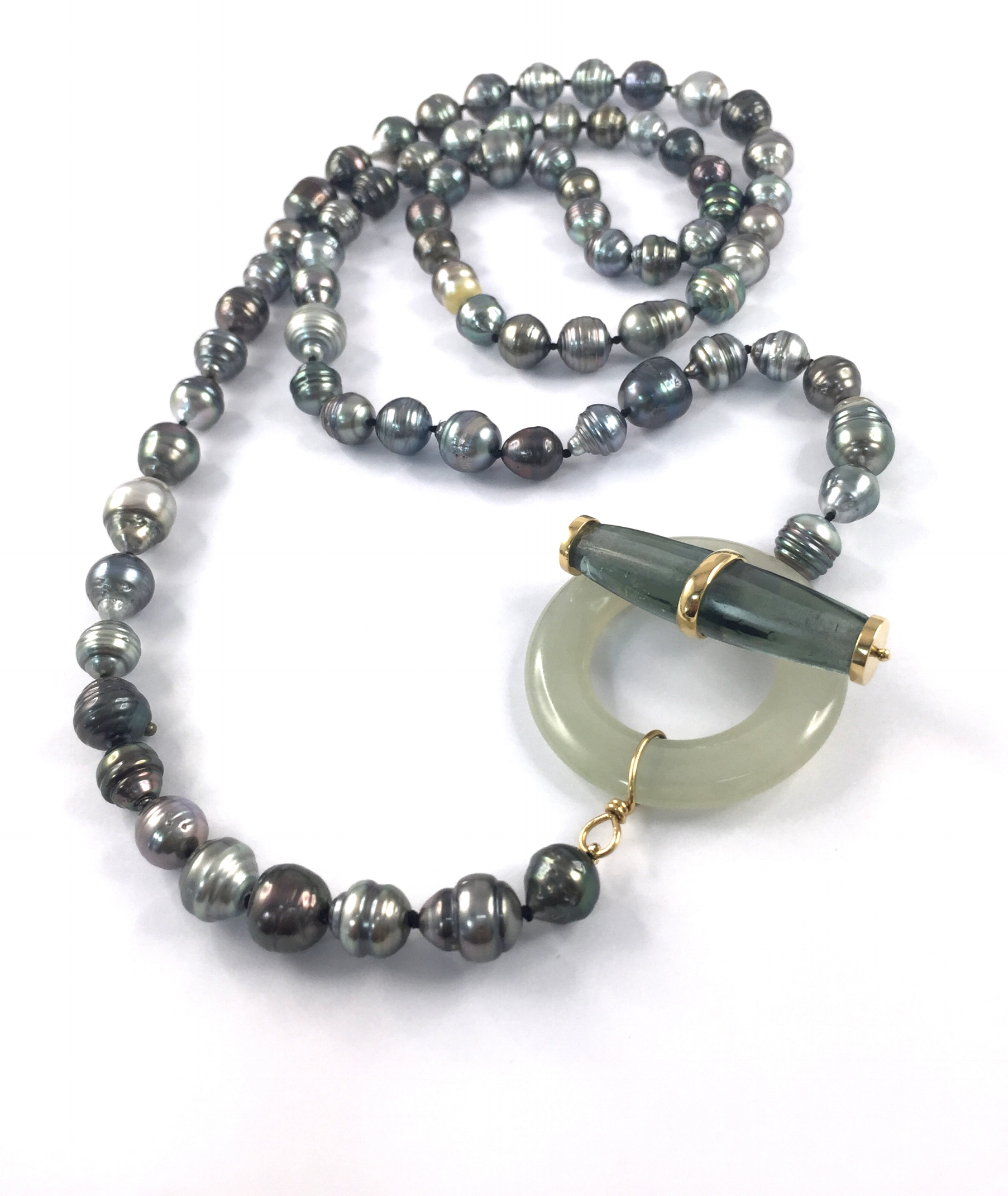 Strand of Tahitian Pearl clasped by antique Glass Trade Bead bar and contemporary jadeite toggle ring