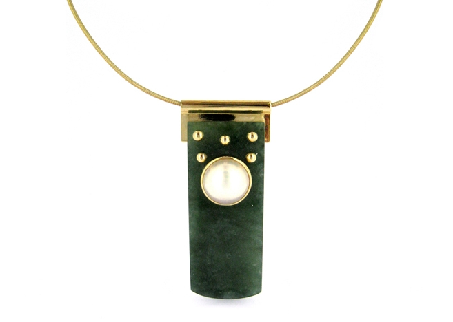 Autumn Moon in Forest. Inspired by the shape and rivets of the end flap of the Courtier's belt, this slide pendant in 18-karat gold of rich Spinach Jadeite is highlighted with a luminous Akoya Mabe pearl.