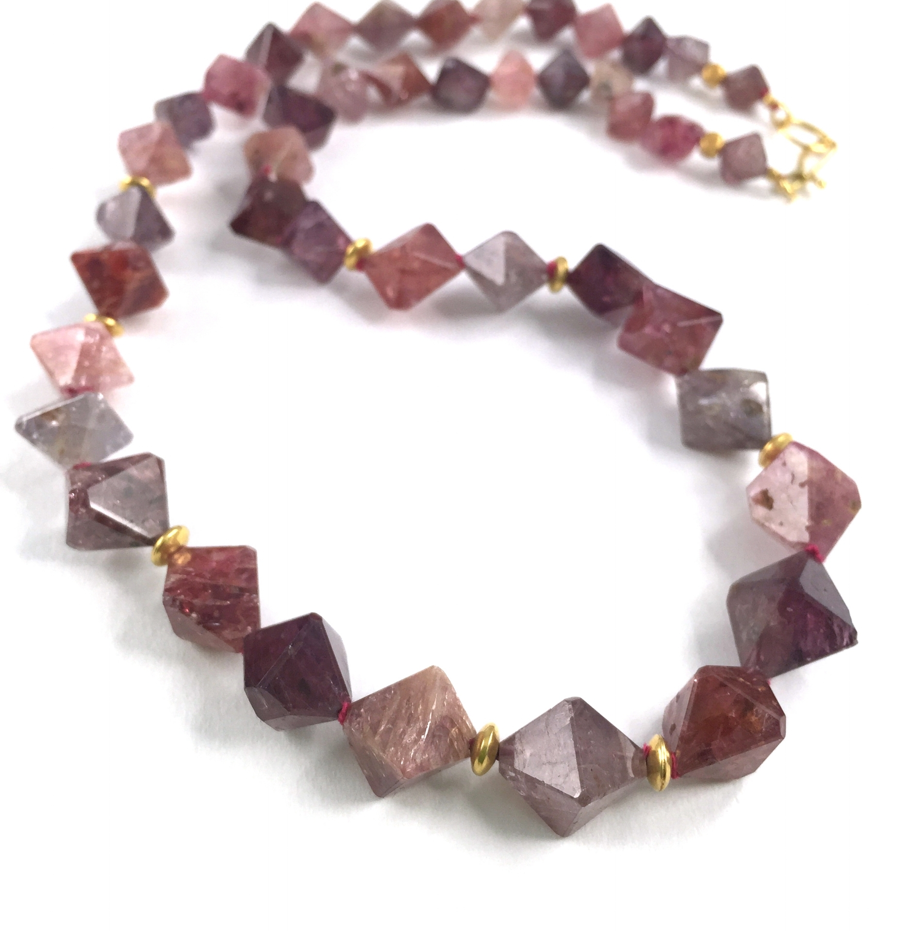 strand of natural spinel with indian gold beads necklace and closure in 18K.