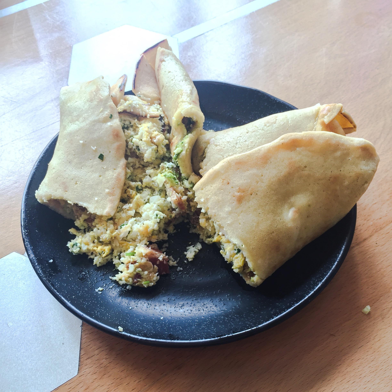 Breakfast burrito with cauliflower rice and coconut wrap