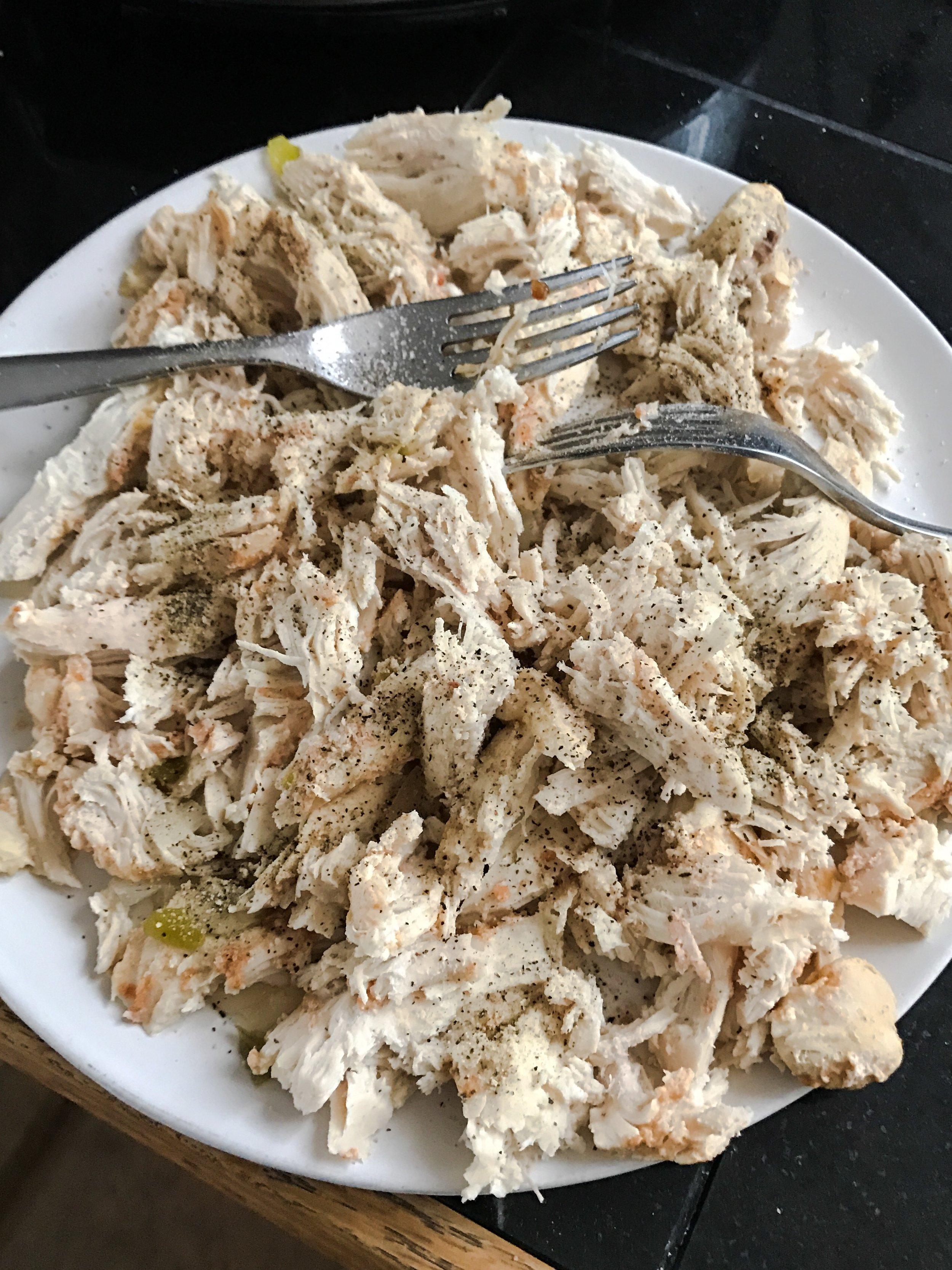 Shred your chicken and don't forget to add pink salt and pepper before putting it back in the crock pot!