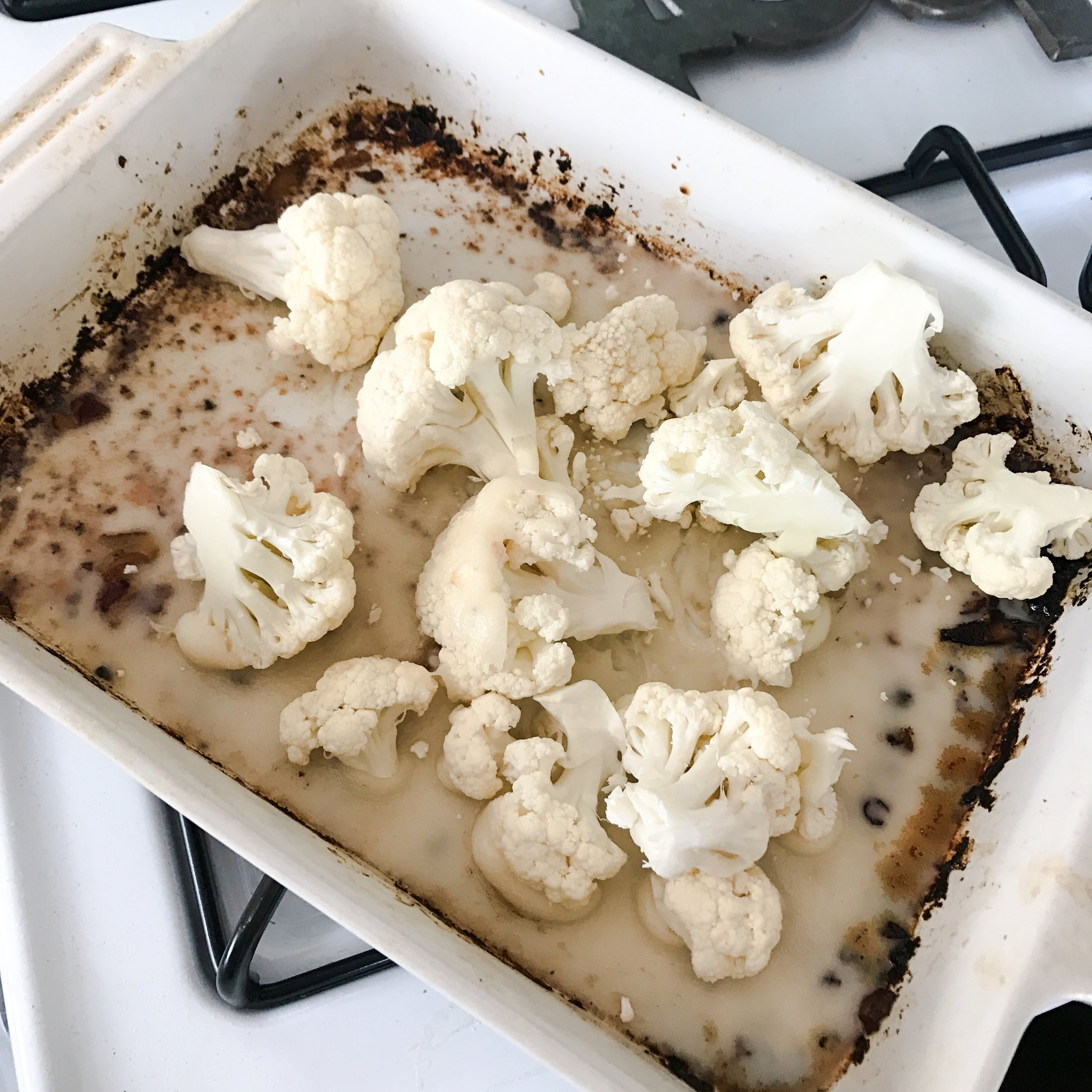 Here is the cauliflower in the hardened bacon grease. I just pop it in the oven just like that- no seasoning or anything at this point. I let it bake for about 15 minutes and then pull it out to stir and season.