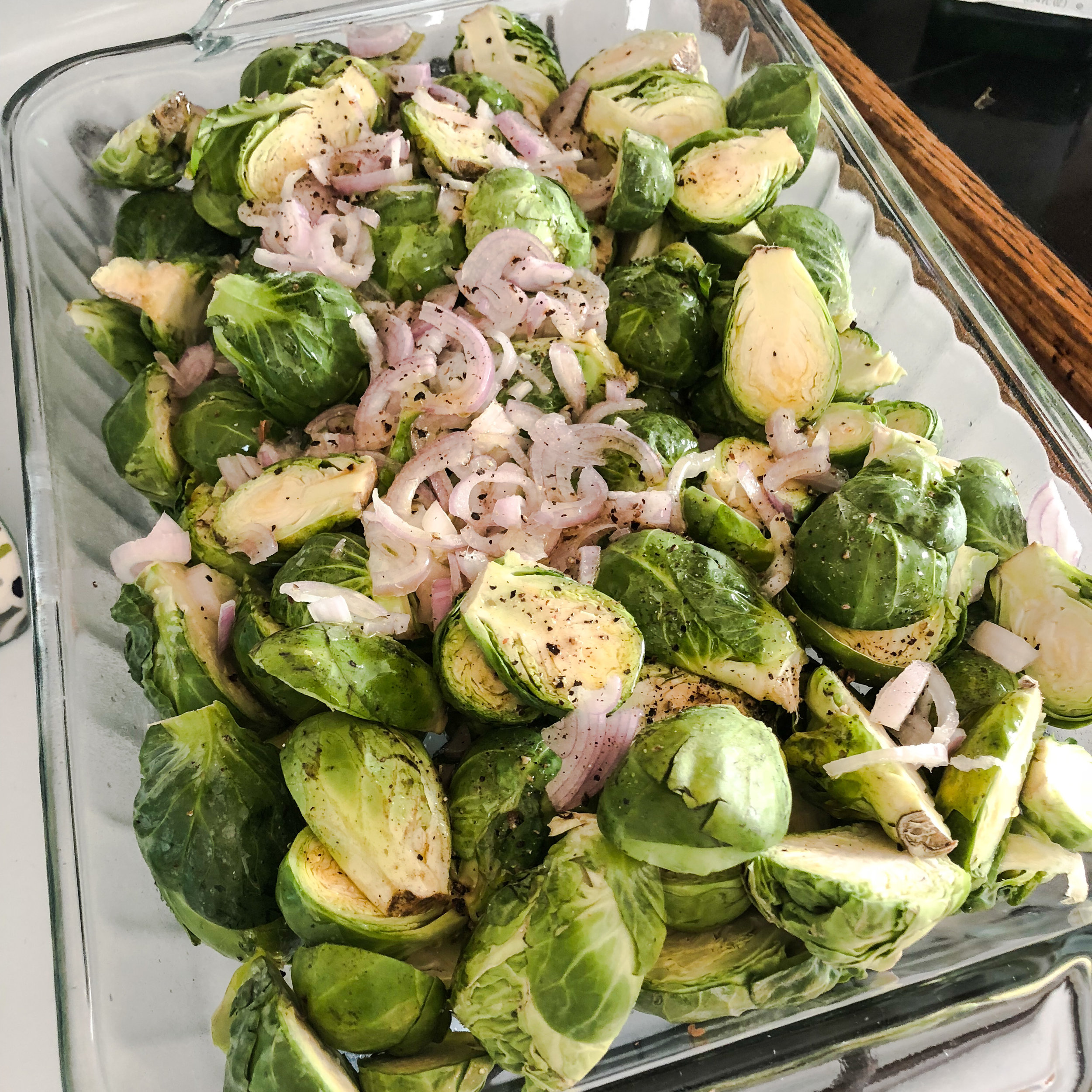 Step 1: 3lbs of halved Brussels sprouts, 3 shallots sliced thin, olive oil, salt and pepper. Roast at 425 for 15 minutes, stir halfway through.