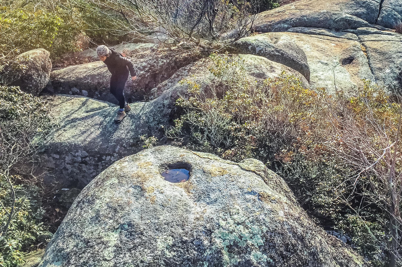 Raisa scrambling granite rock formations