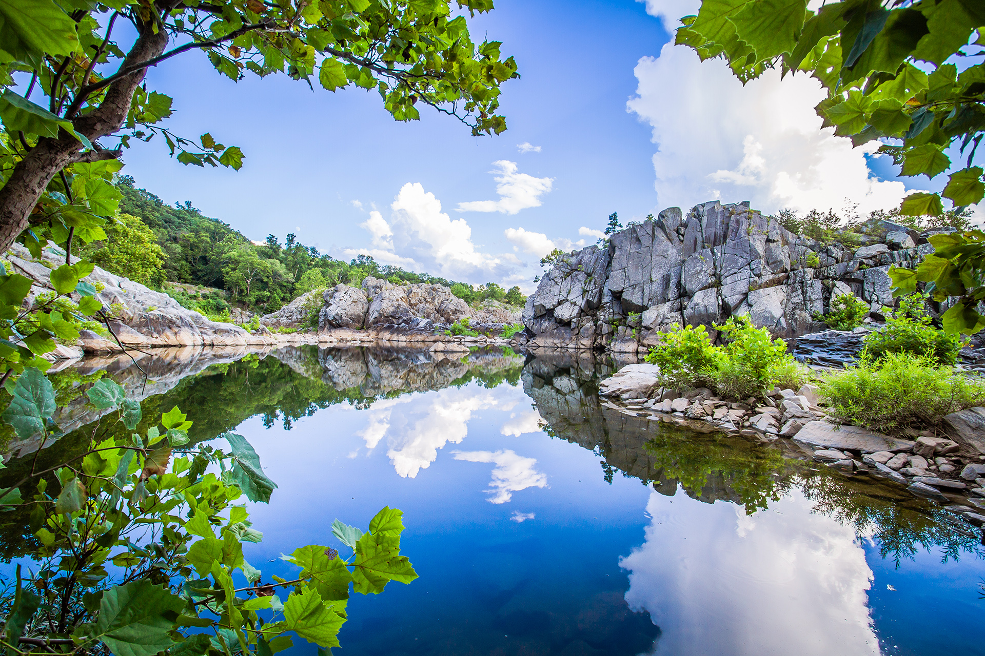 Lagoon at Great Falls reflecting cloudy sky